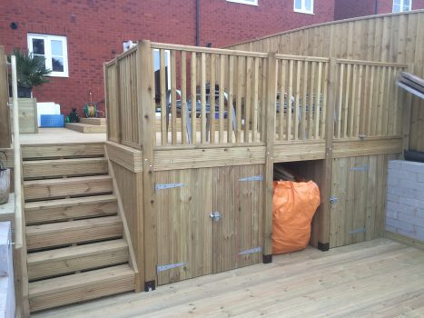 Hidden bin store and storage area under decking
