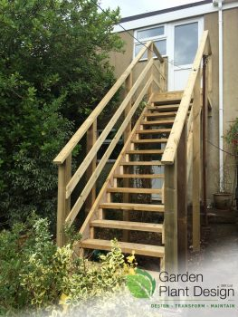 custom made timber staircase leading up to garage door